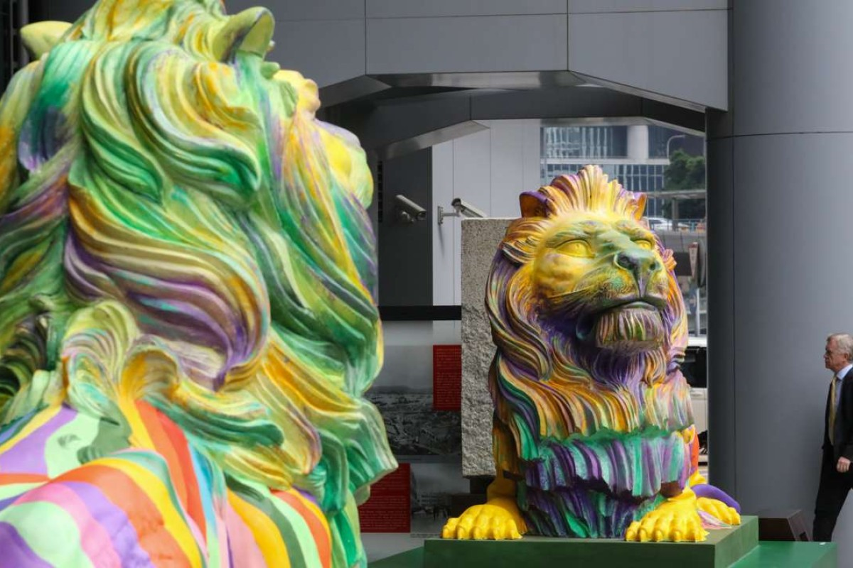 Coloured lion statues at HSBC headquarters in Central, Hong Kong. The rainbow-coloured lion statues, created by LGBT artist Michael Lam and on show all month, represent pride and unity in diversity. Photo: Felix Wong
