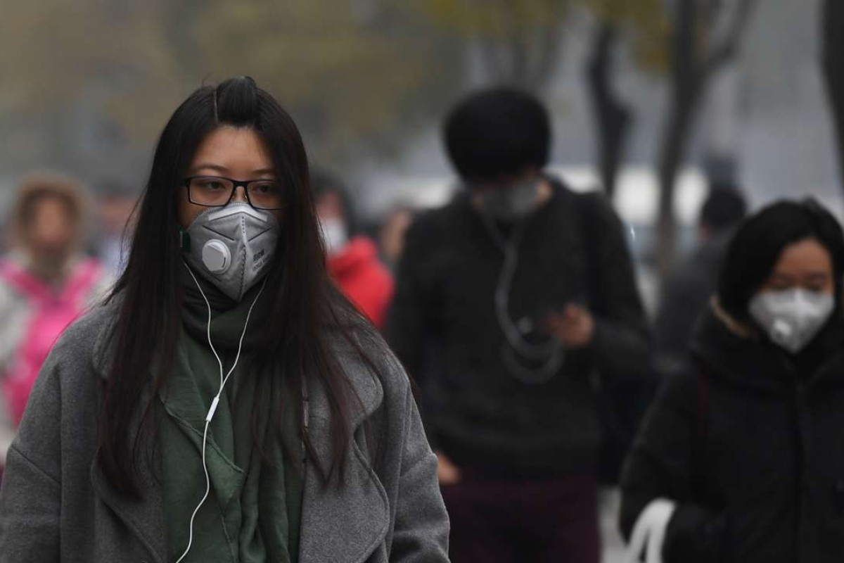 People wear masks as Beijing goes on high alert for pollution. Despite its reputation, the city is far from the world's – or even China's – most polluted city. Photo: AFP