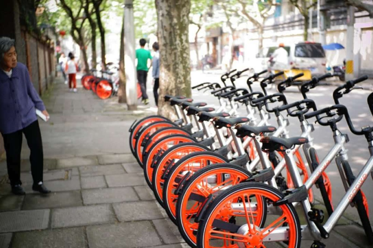 Mobikes await their hirers in Beijing.