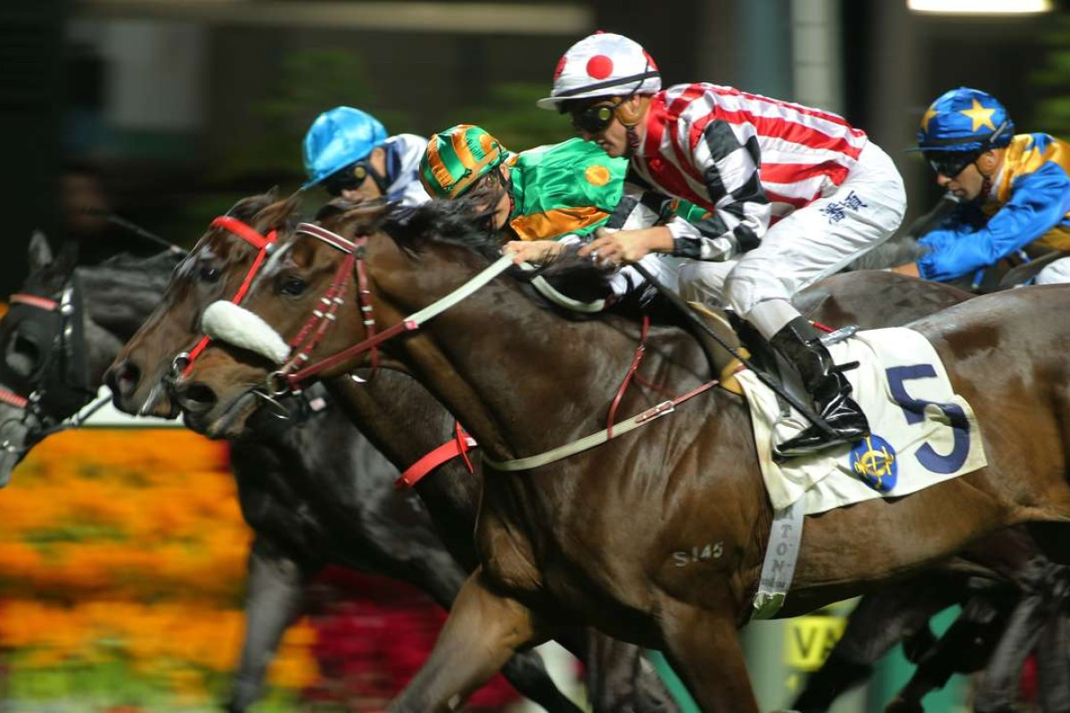 Harbour Master storms over the top of his rivals in the Group Three January Cup after a gem of a ride from Zac Purton. Photos: Kenneth Chan