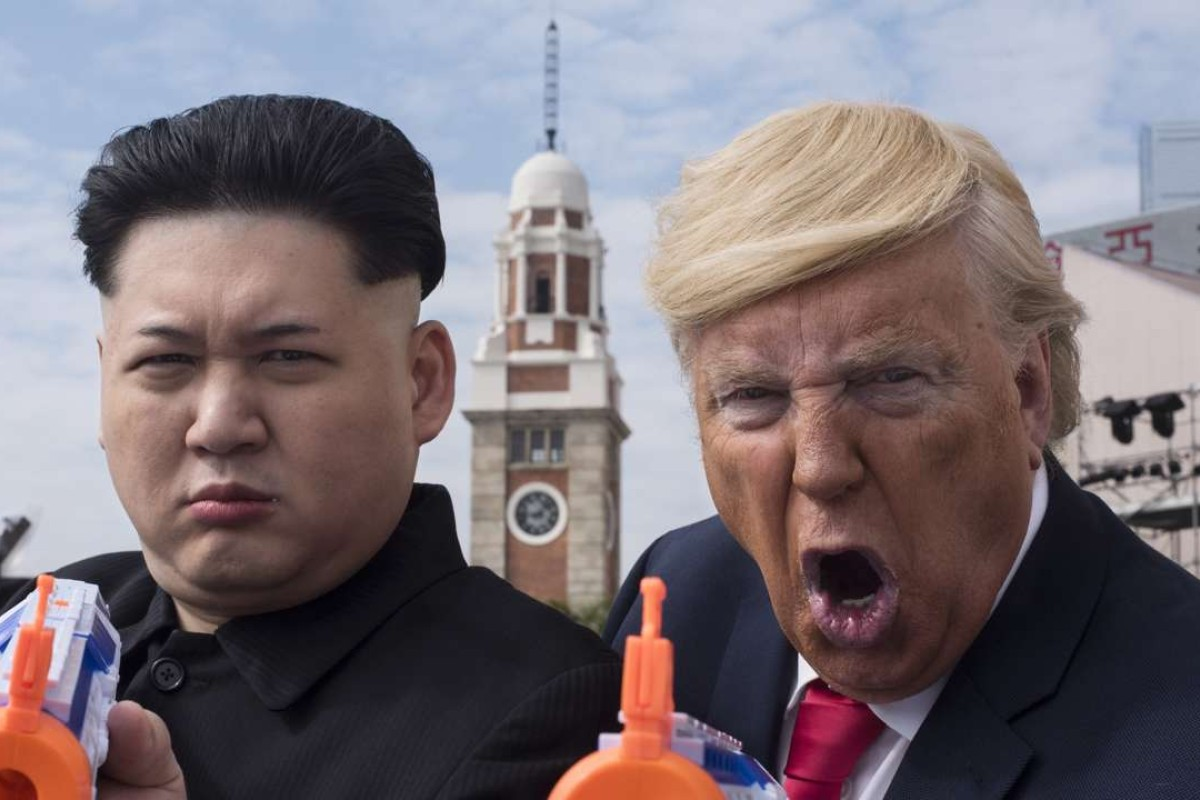 Donald Trump impersonator Dennis Alan and a Kim Jong-un impersonator who just wants to be called Howard act up on Hong Kong's Tsim Sha Tsui waterfront. Pictures: Miguel Candela