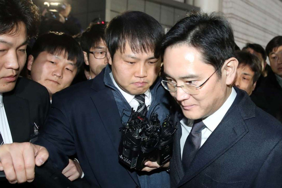 Samsung Group's heir apparent Lee Jae-Yong, right. Photo: AFP