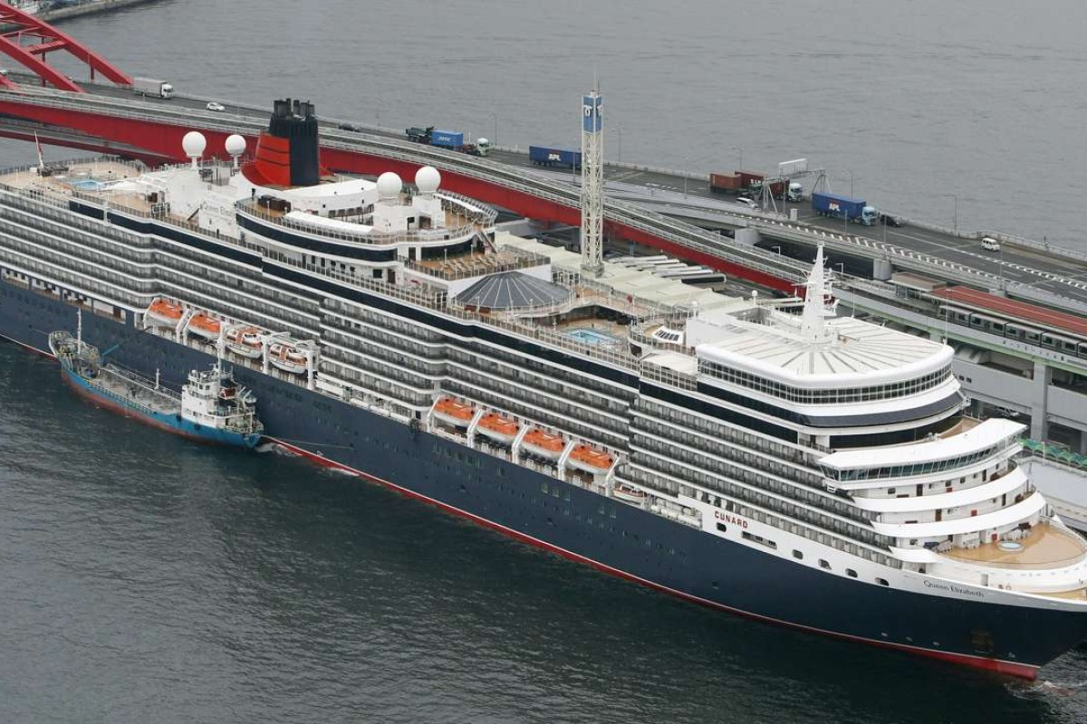 Luxury liner Queen Elizabeth arrives at the port of Kobe, Japan, on March 13, 2017. The 90,901-ton cruise ship is on an around-the-world voyage. The photo was taken from a Kyodo News helicopter. (Kyodo) ==Kyodo