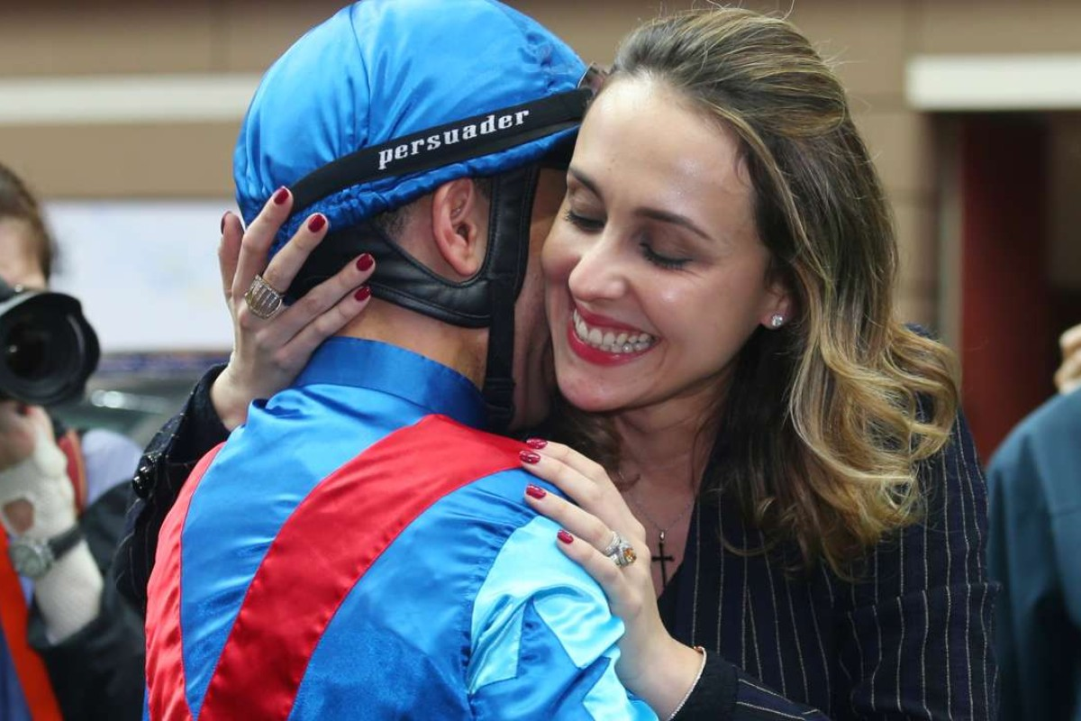An overwhelmed Joao Moreira gets a big hug from wife Taciana after winning the BMW Derby aboard Rapper Dragon. Photos: Kenneth Chan