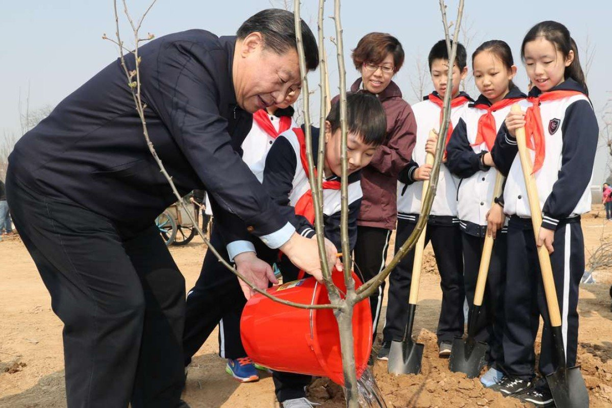 Chinese President Xi Jinping helps children water a sapling as he attends a tree-planting activity in Beijing. The leader has two major events in the coming weeks that are likely to raise China's profile on the global stage. Photo: Xinhua