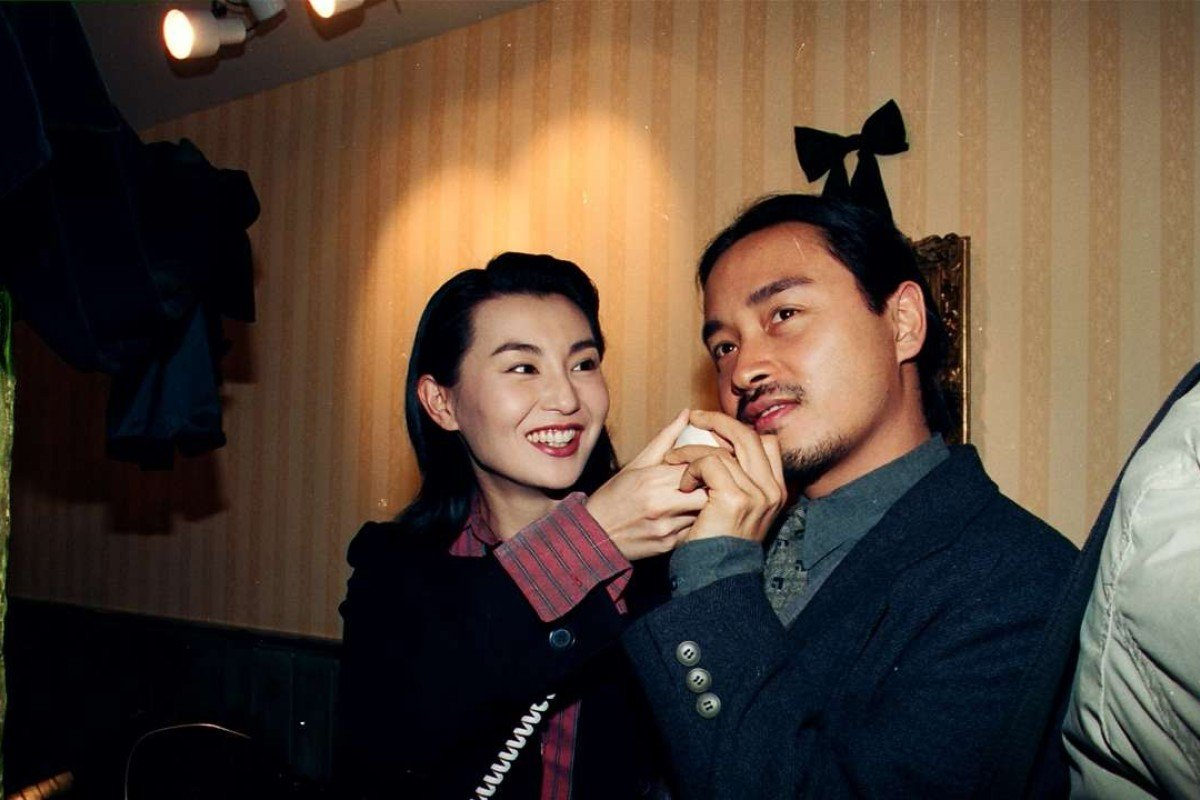 Charming Maggie Cheung Man-yuk and singer Leslie Cheung Kwok-wing attending the opening ceremony of hairdresser Kim Robinson's branch of Le Salon Orient in Times Square.