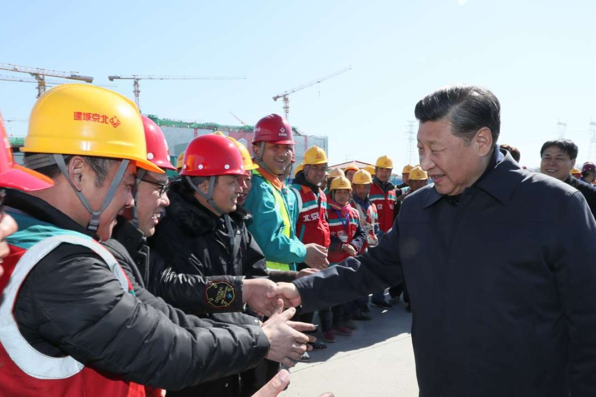 Chinese president xi jinping shakes hands with workers at the construction site of the capital s subsidiary