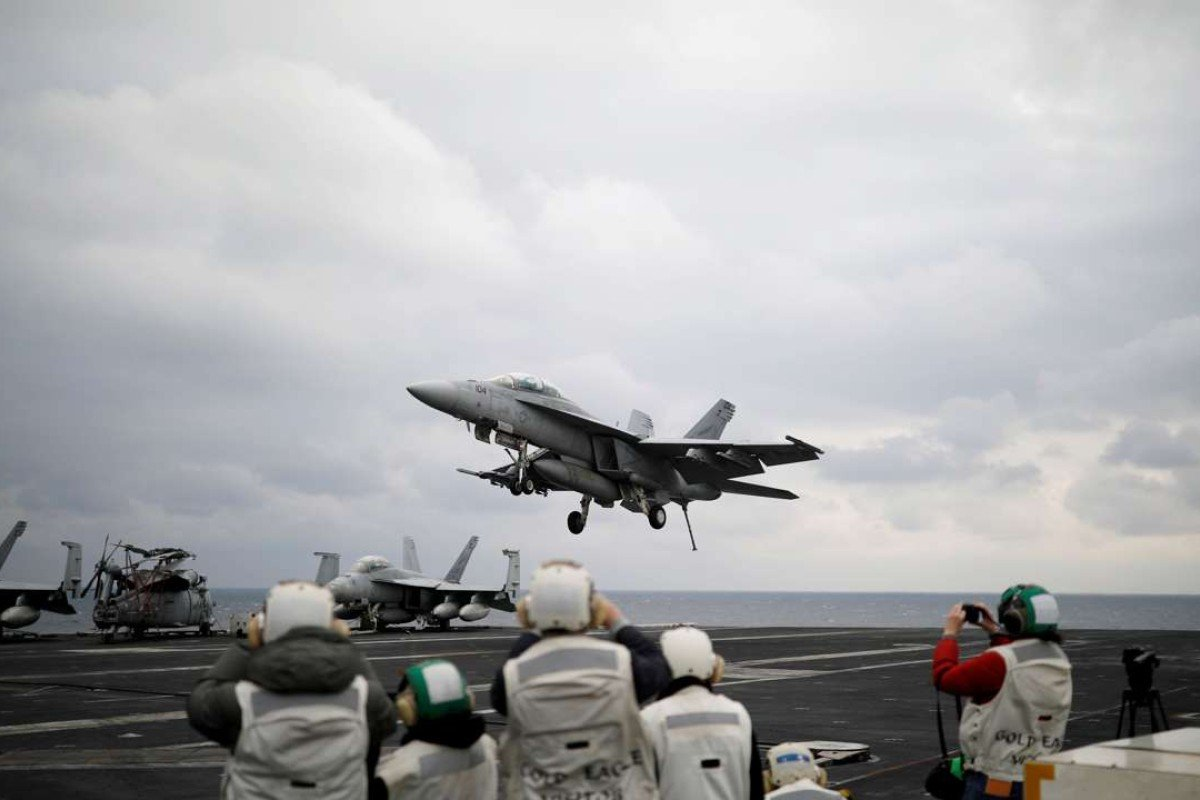 A US F18 fighter jet lands on the deck of US aircraft carrier USS Carl Vinson. Photo: Reuters
