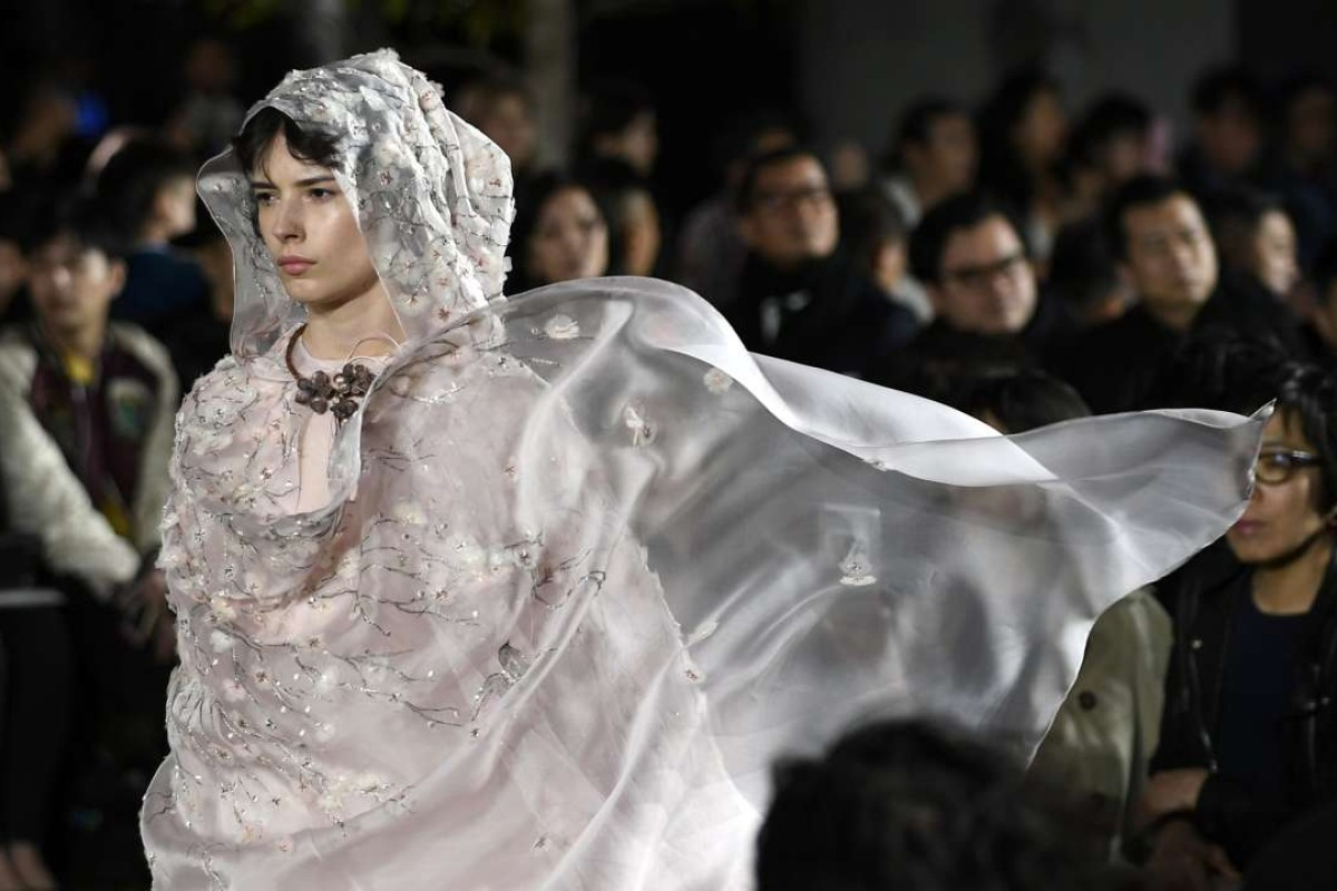 Christian Dior's spring-summer 2017 haute couture collection by Italian designer Maria Grazia Chiuri on the rooftop garden of the Ginza Six new retail complex in Tokyo. Photo: EPA