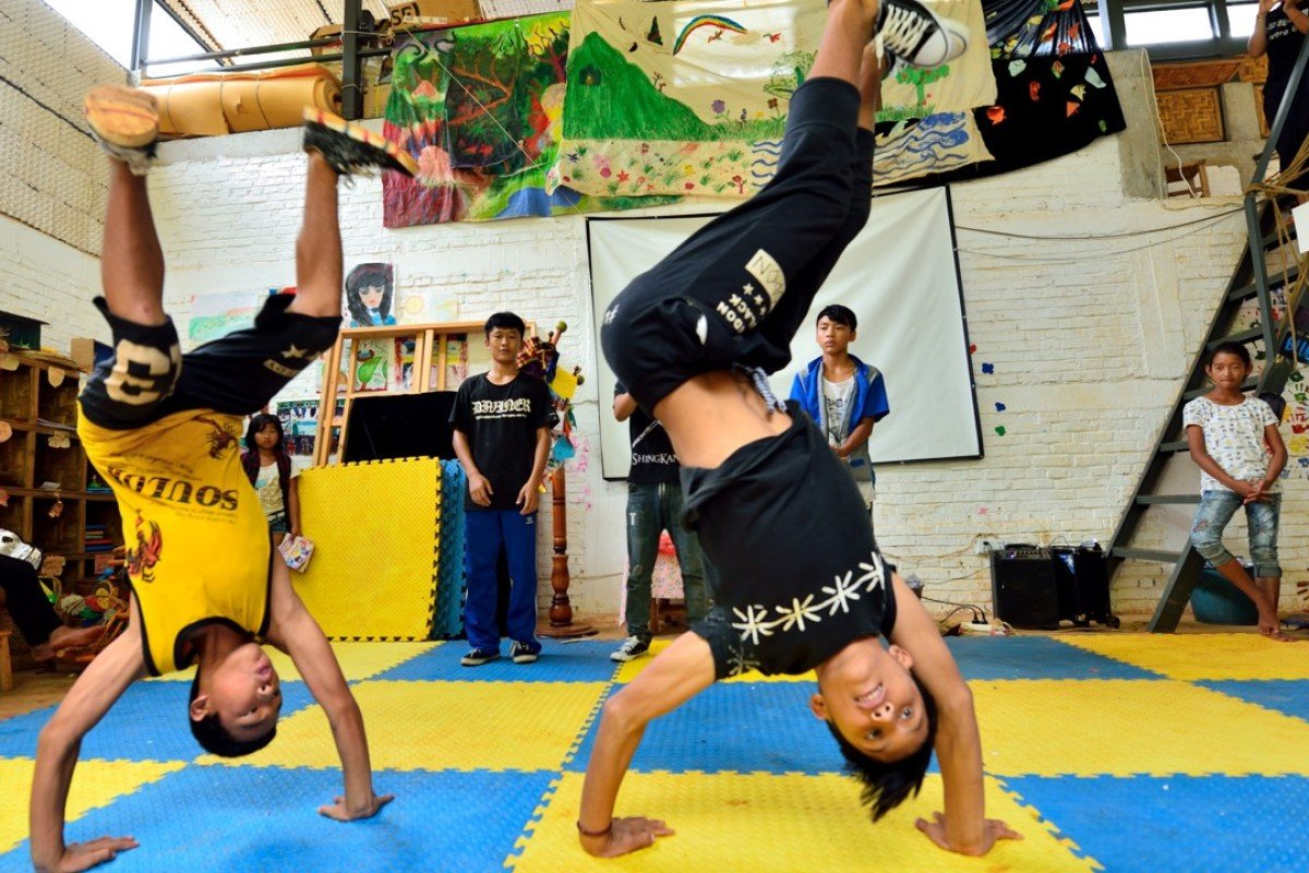 Two students at Prop Roots Education Centre in Yingpan village practise their street-dancing routine. Photo: Prop Roots