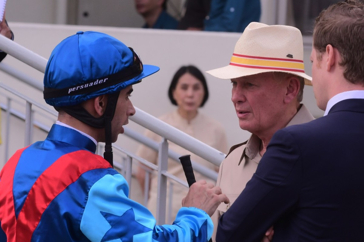 Rapper Dragon jockey Joao Moreira and trainer John Moore after race seven. Photo: Kenneth Chan