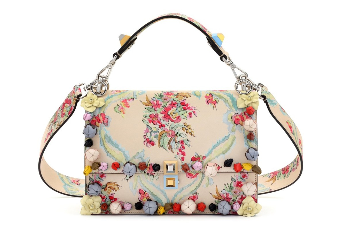 Fendi. The wide range of straps makes the cutest functional accessory on top of the candy-coloured studs, rosette embroidery and floral ribbons of the Kan I stud lock bag. Bag: HK$39,000; Strap: H$5,600-HK$35,900
