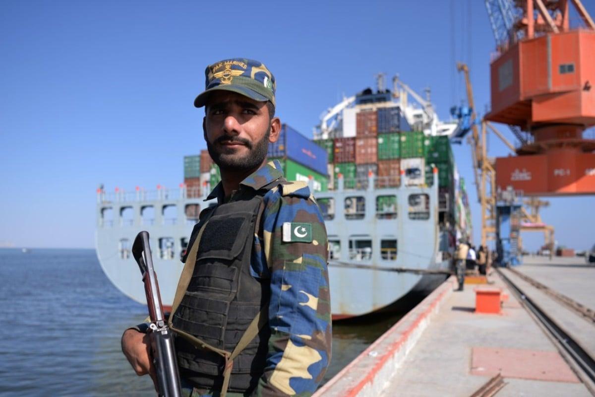 A Pakistani guard beside a ship docked at Gwadar port. Photo: AFP