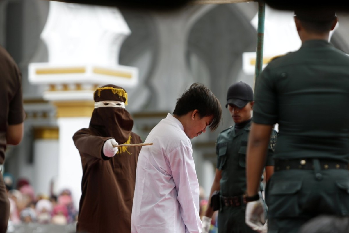 A man is whipped in front of the public as punishment for having gay sex in Banda Aceh, Indonesia. Photo: EPA