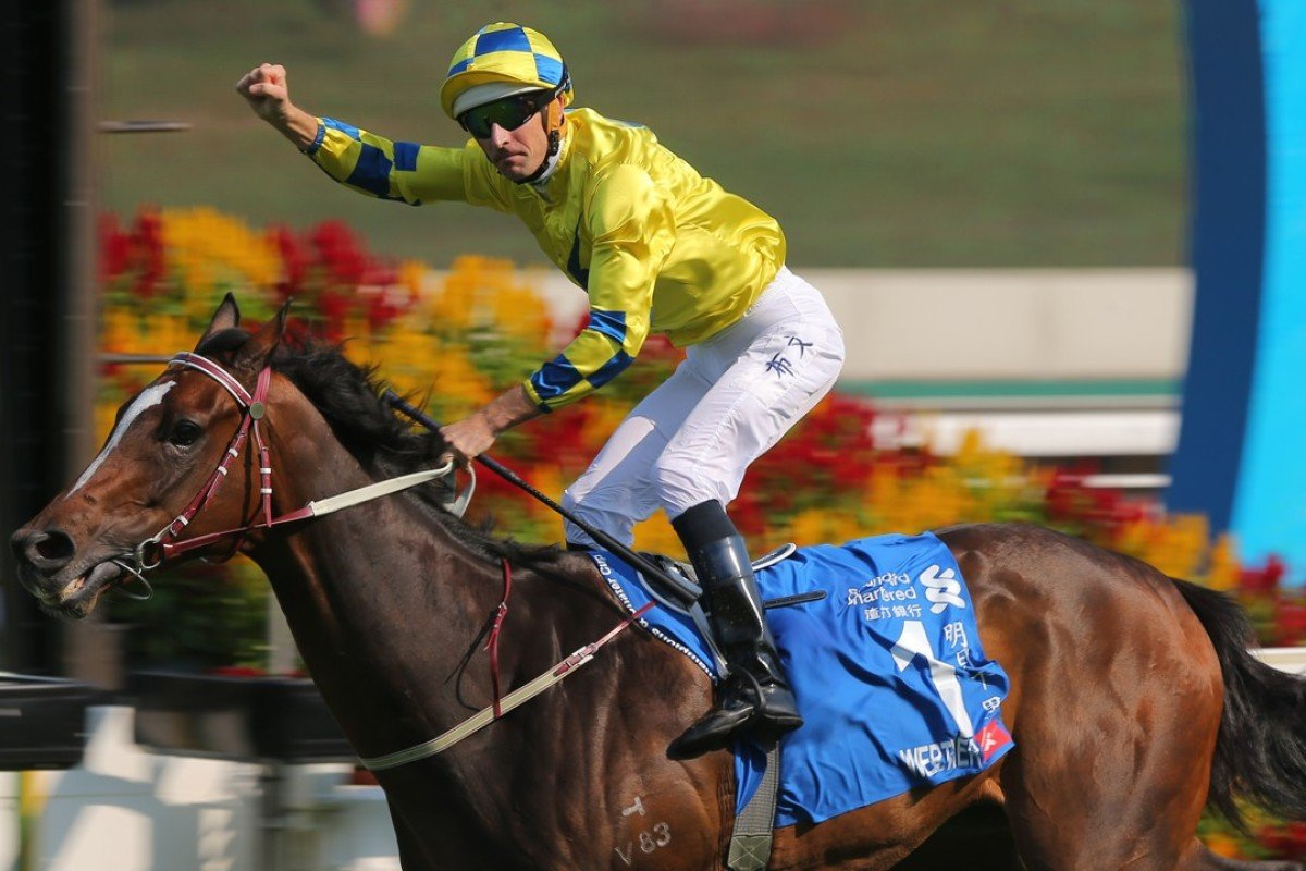 Hugh Bowman salutes as Werther wins the Standard Chartered Champions & Chater Cup. Photo: Kenneth Chan