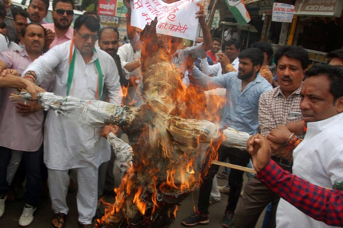 Demonstrators burn an effigy depicting Madhya Pradesh Chief Minister Shivraj Singh Chauhan during a protest organised by India's main opposition Congress Party in Bhopal, India. Farmers, some shot and killed by police, are demanding loan forgiveness. Photo: Reuters