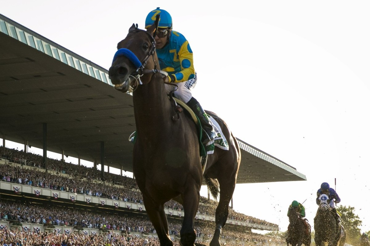American Pharoah wins the 2015 Belmont Stakes to complete the Triple Crown. Photo: REUTERS/Lucas Jackson