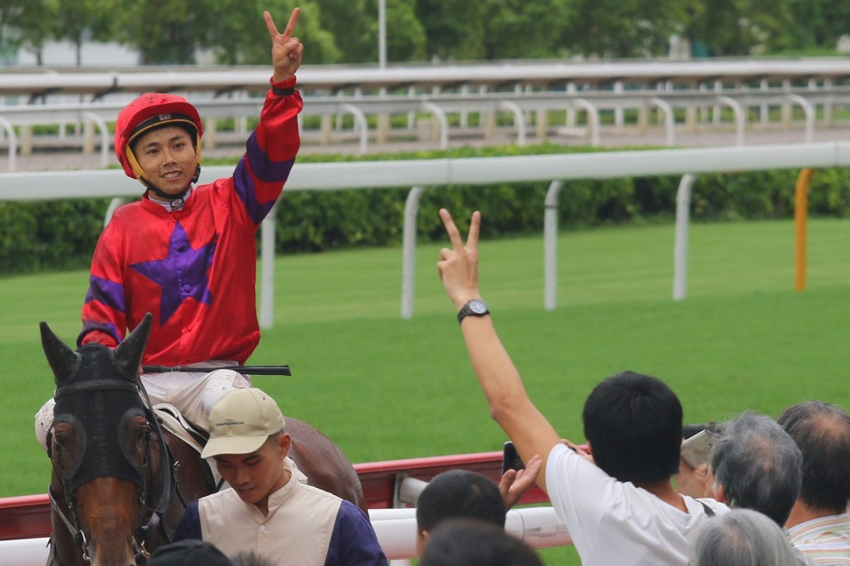 Matthew Poon celebrates with the crowd at Sha Tin after winning on Victory Boys. Photos: Kenneth Chan