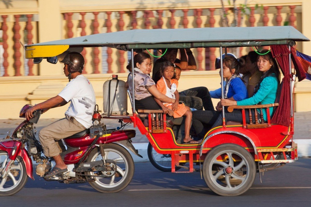 A family travels via tuk-tuk in Phnom Penh, Cambodia. Handout photo