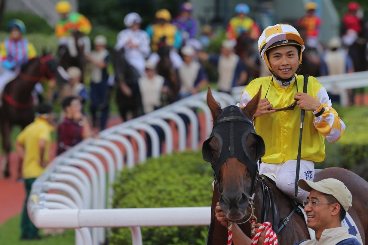 Matthew Poon is all smiles after winning aboard Penang Hall. Photos: Kenneth Chan