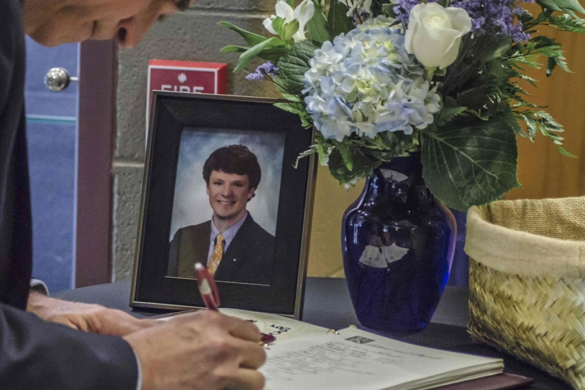 A mourner signs a guest book at Otto Warmbier's funeral. Picture: AFP