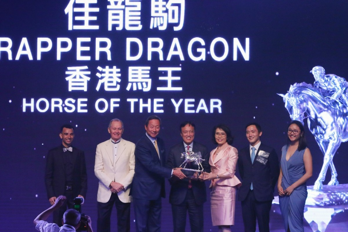 Rapper Dragon's owner, Albert Hung, celebrates with the trophy after winning Horse of the Year. Photos: Kenneth Chan