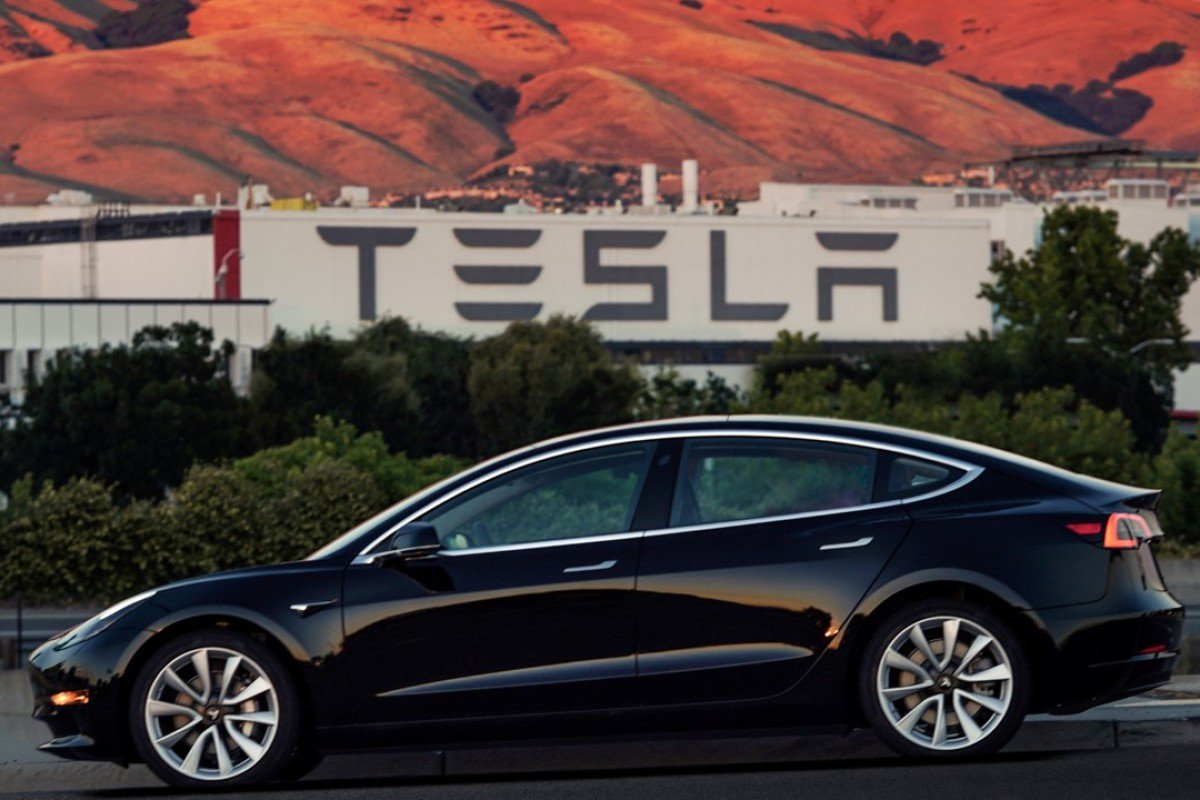 The first production model of Tesla Model 3 out the assembly line in the US. Photo: REUTERS