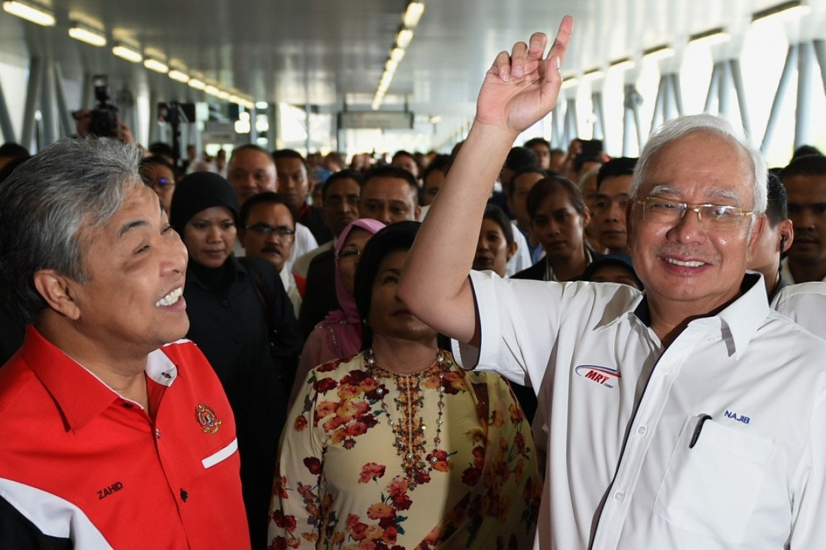 Malaysian Prime Minister Najib Razak, right, and Deputy Prime Minister Ahmad Zahid Hamidi arrive at Kajang station to launch the Sungai Buloh-Kajang MRT line in Kuala Lumpur. Photo: AFP