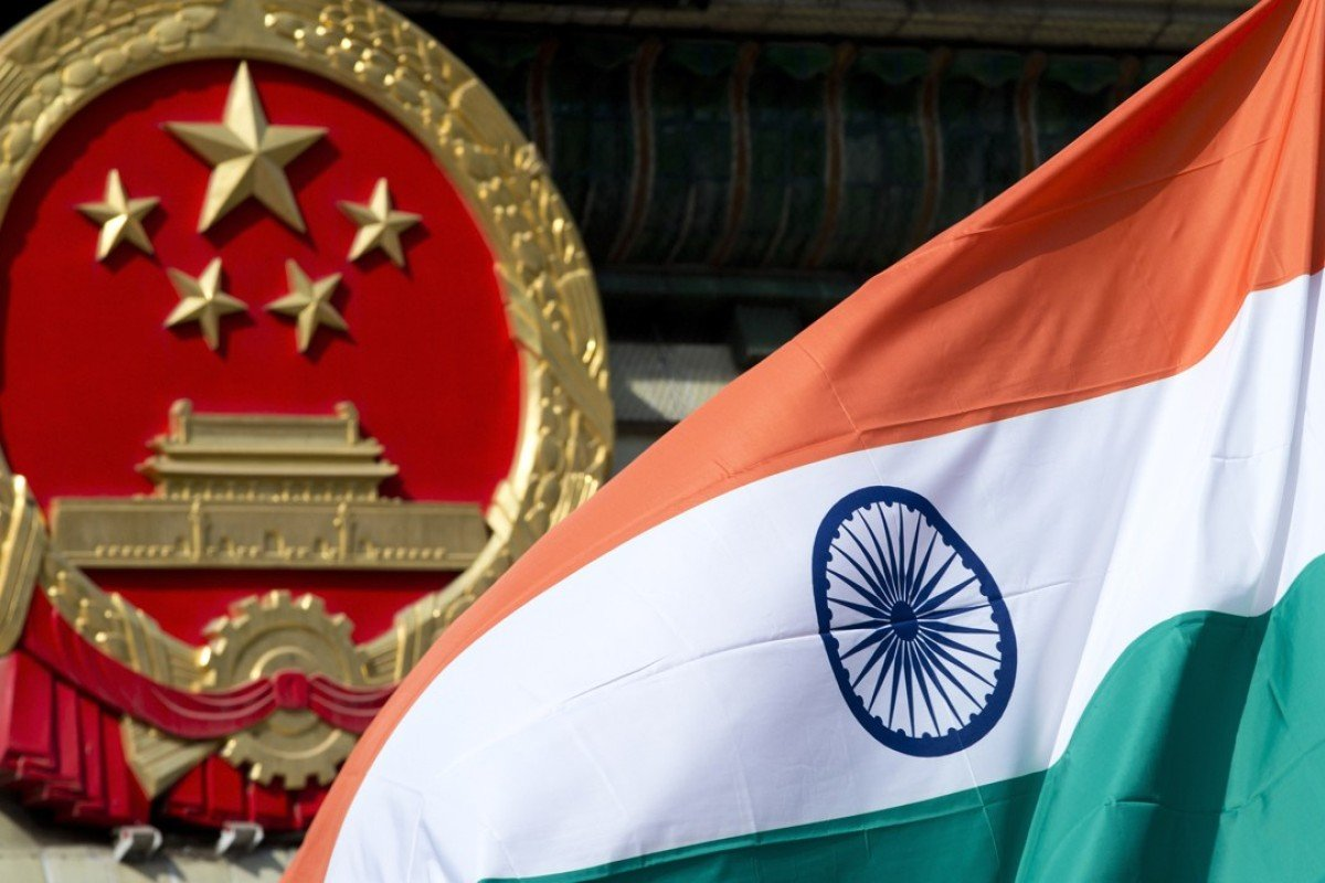 A Chinese emblem and an Indian flag at the Great Hall of the People in Beijing. Photo: AP