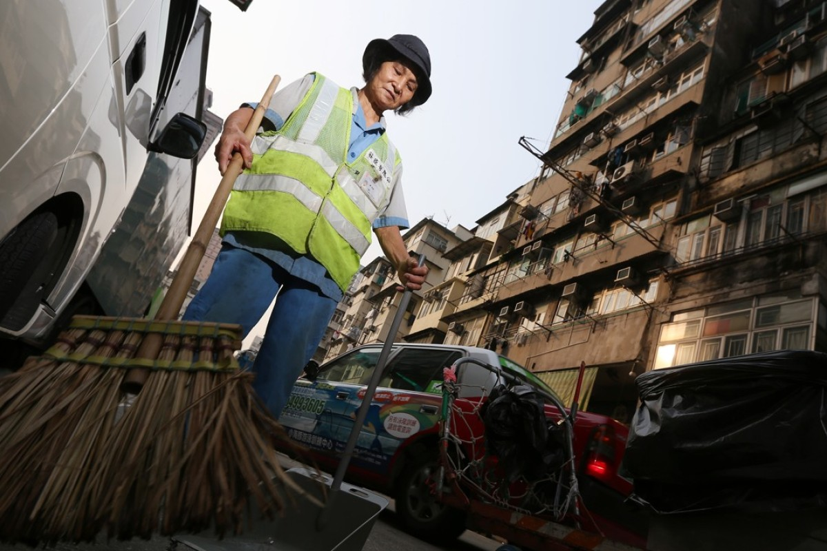 A street sweeper in Sham Shui Po. Pictures: SCMP