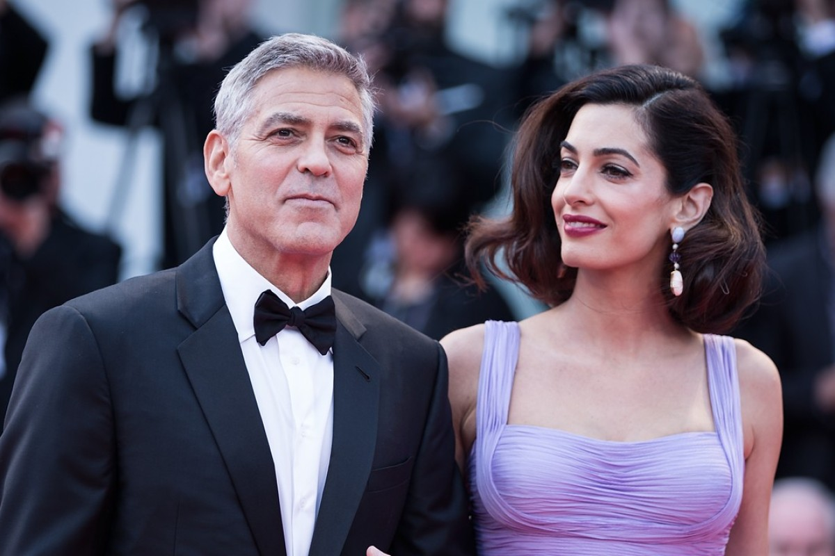 Director George Clooney and his wife Amal attend the premiere of the movie 'Suburbicon' in competition at the 74th Venice Film Festival. Photo: Xinhua
