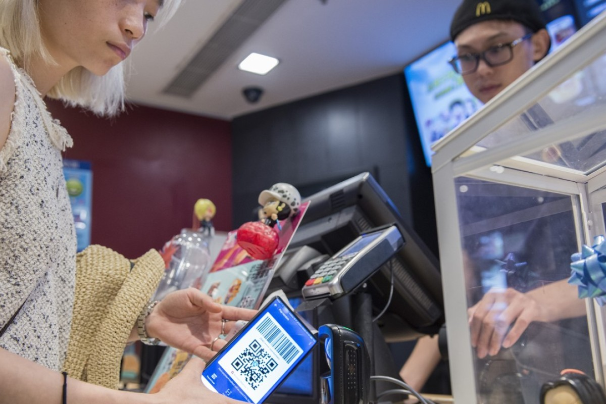 A customer uses her smartphone to pay at a McDonald's in Shanghai. Pictures: Zigor Aldama