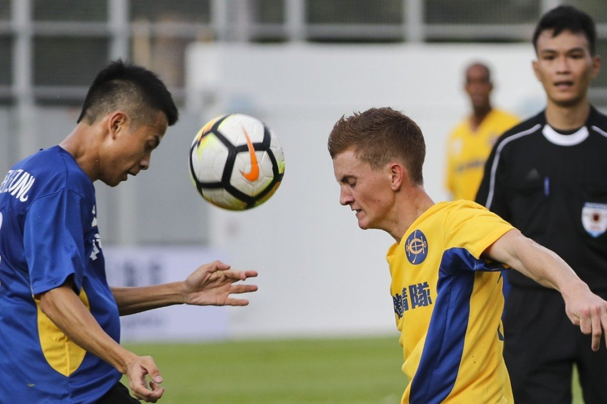Derek Leung and Chad Schofield compete for the ball at Mong Kong Stadium. Photos: Edward Wong