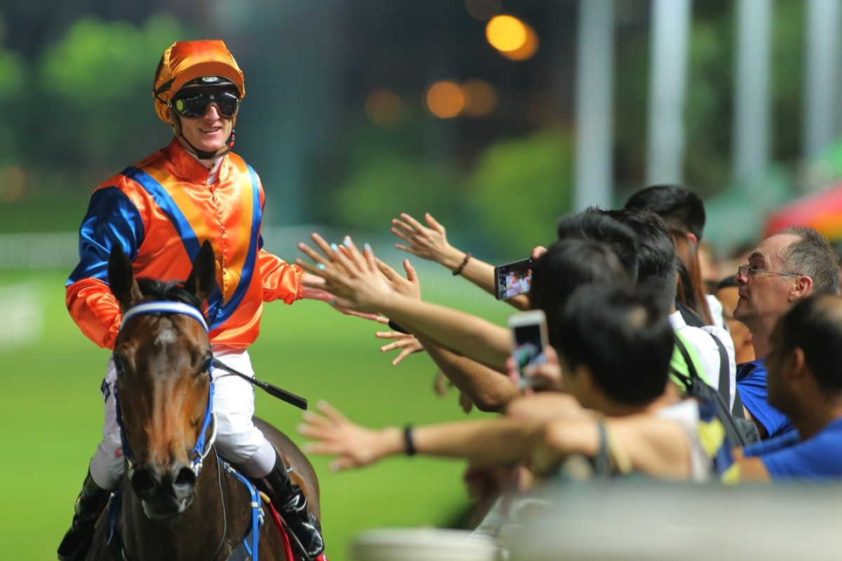 Zac Purton celebrates Best Step's victory with the fans at Happy Valley on Wednesday night. Photos: Kenneth Chan