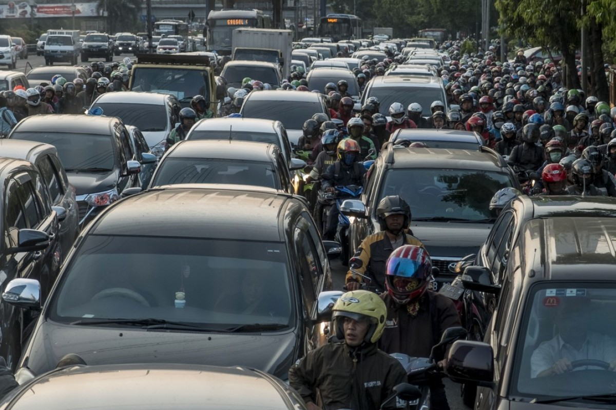 Commuters wait in a traffic jam during afternoon rush hour in Jakarta, Indonesia. Photo; AFP