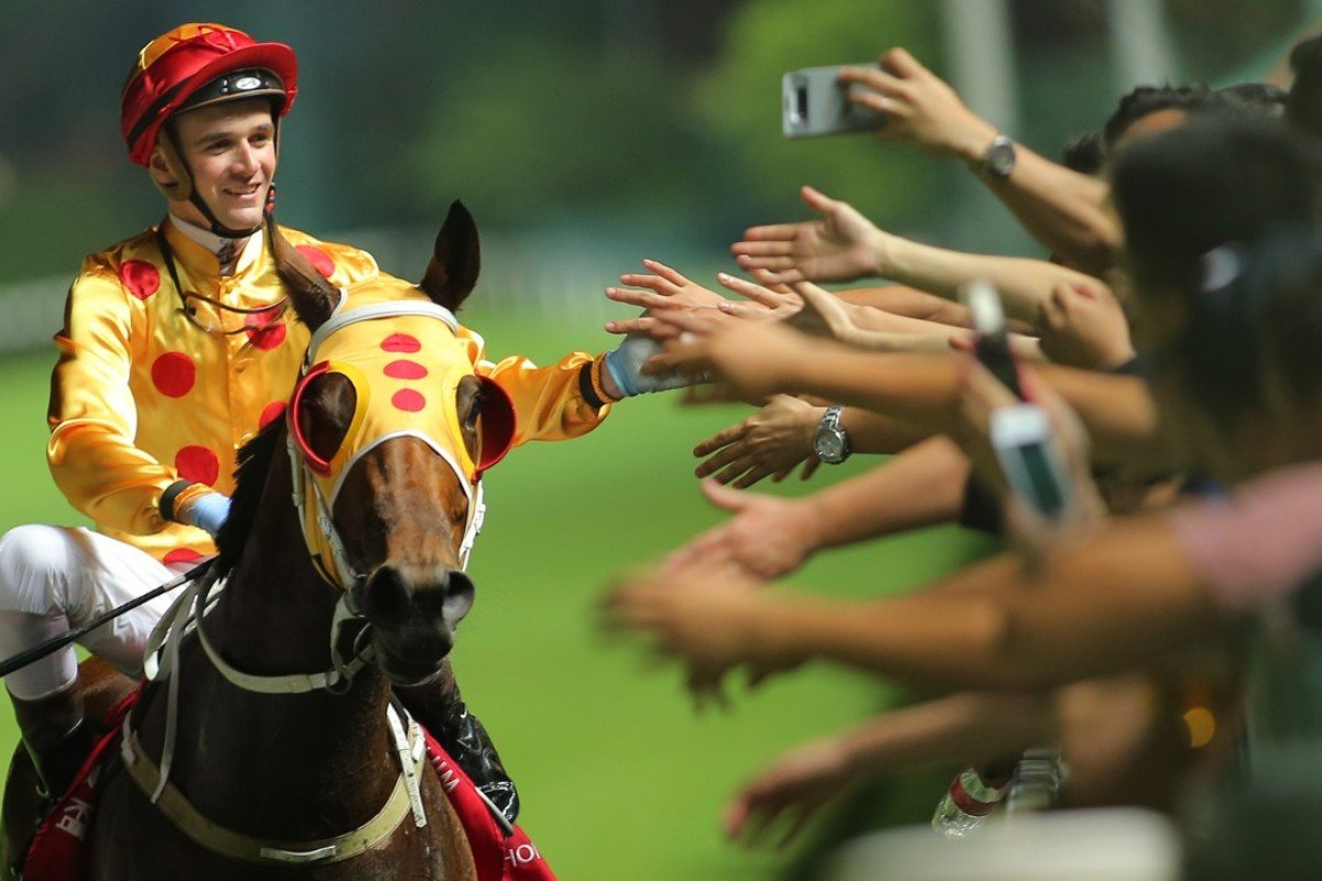Sam Clipperton celebrates Gold Land's win with the fans. Photos: Kenneth Chan