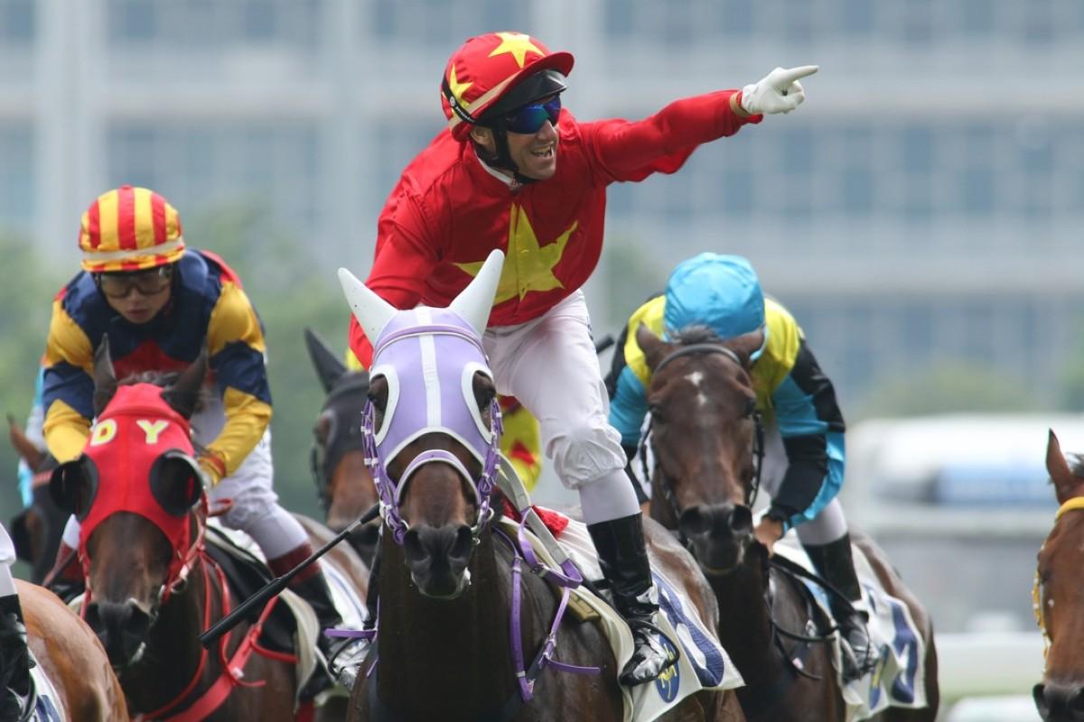 Brett Prebble salutes as King Winsa prevails at Sha Tin on Saturday. Photos: Kenneth Chan