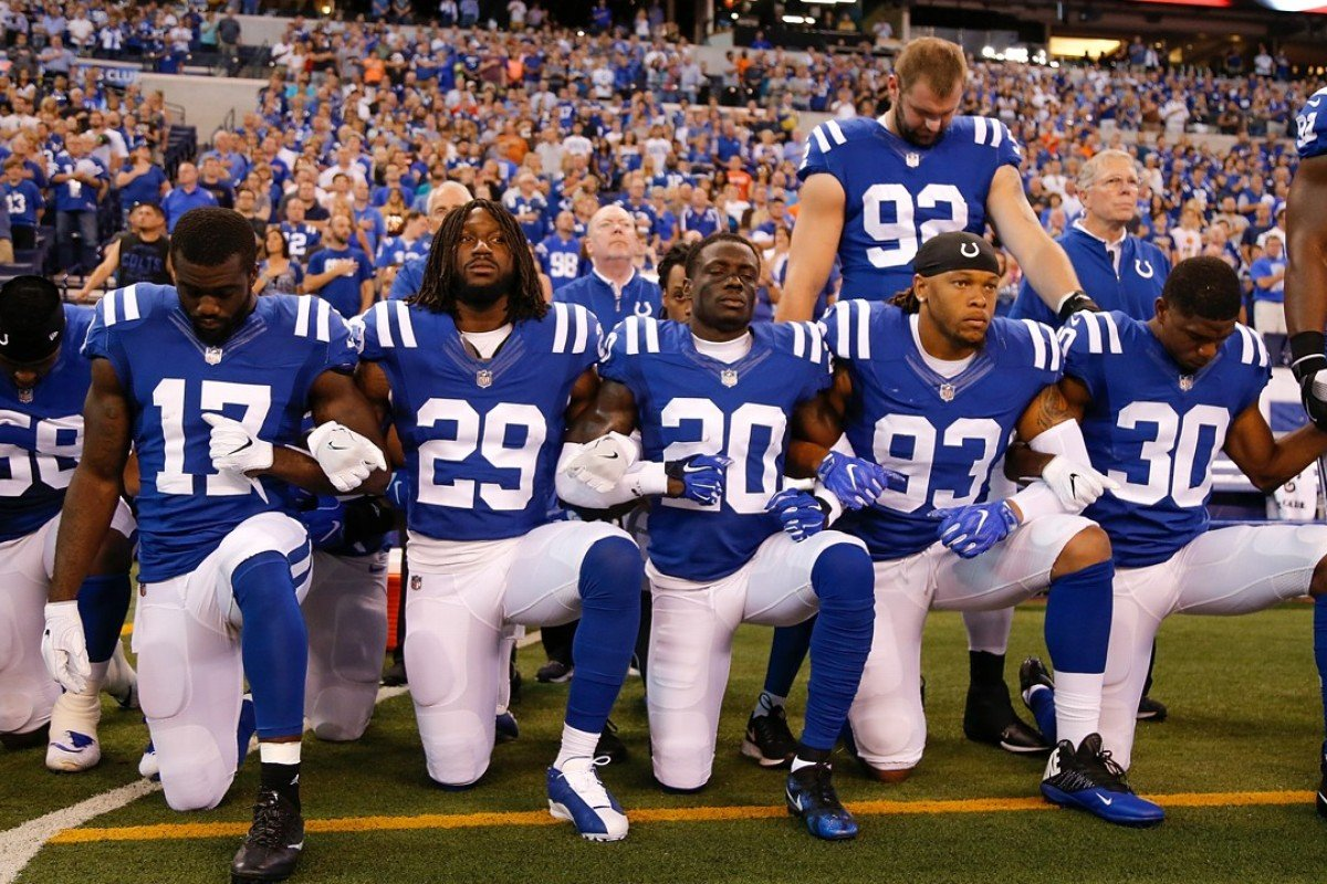 Members of the Indianapolis Colts kneel for 'The Star Spangled Banner'. Photo: AFP