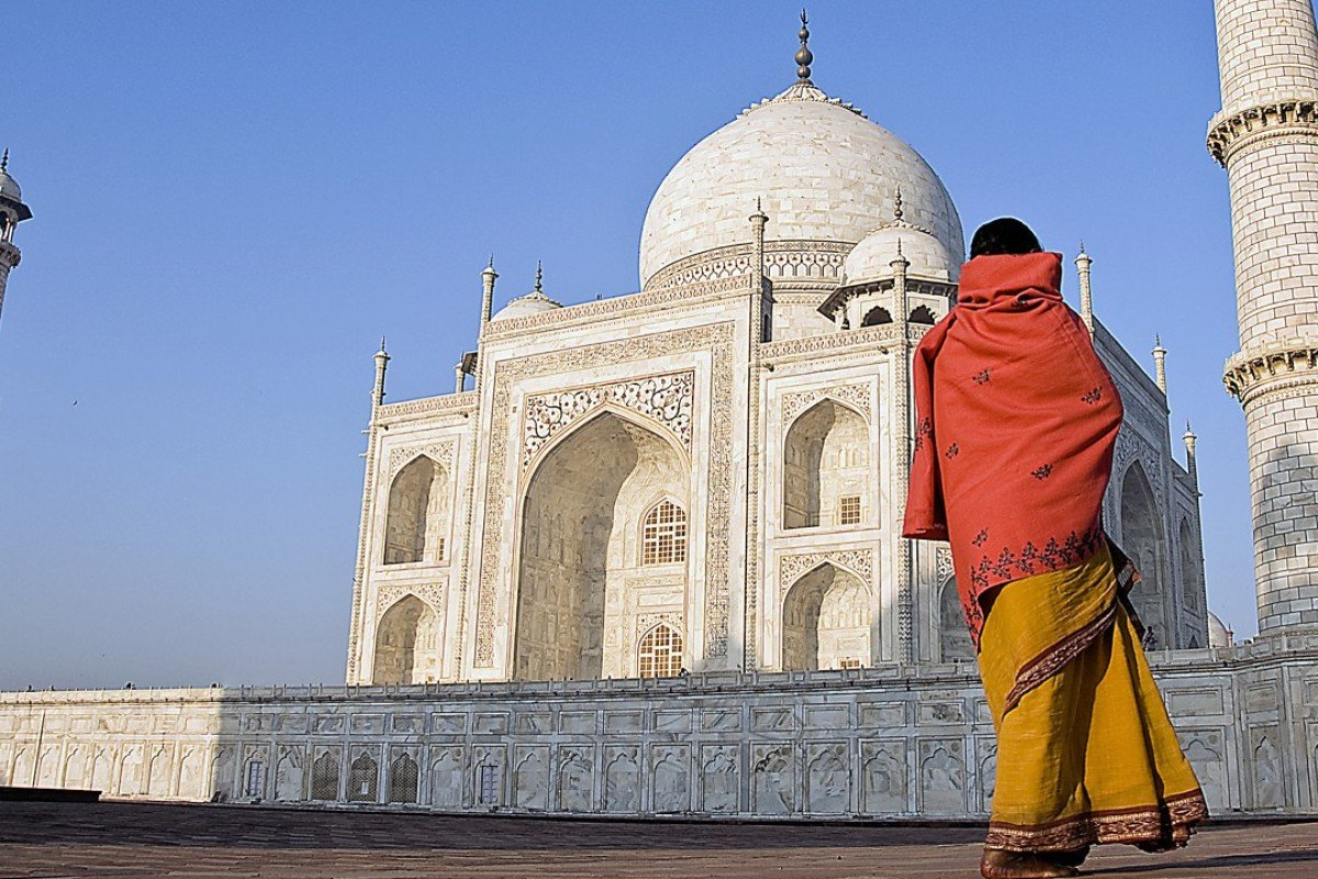 A woman looks up at the facade of the Taj Mahal in Agra, India. Photo: Post Magazine