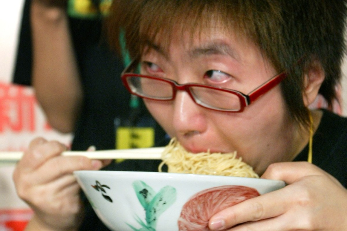Japanese instant noodle maker Nissin Food Products has created what it claims is a world-first 'noise-cancelling' fork to mask the sound made by slurping down food. Photo: Dickson Lee