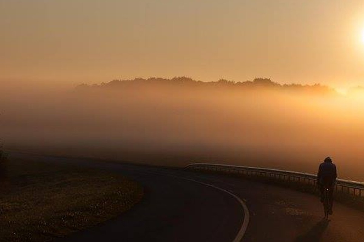 Mark Beaumont watches his final sunrise as he cycles towards Paris on the last day of his world record ride. Photos: Mark Beaumont Facebook
