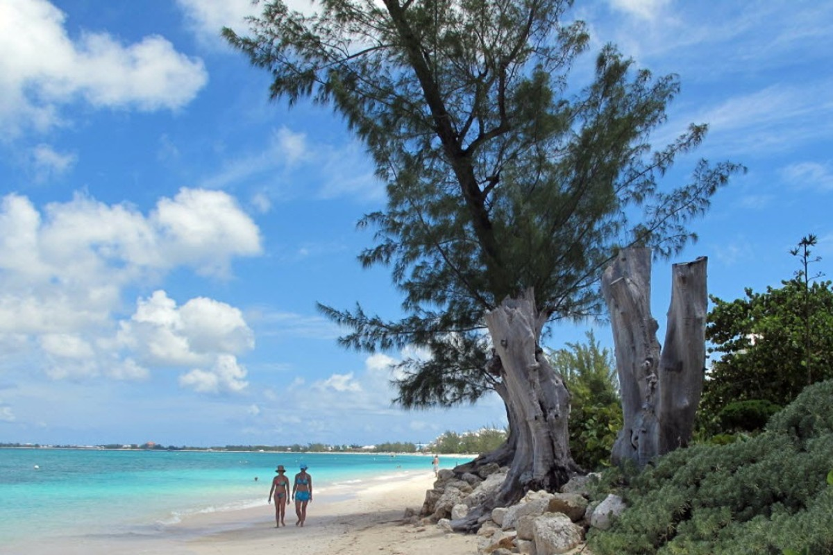 Tourists can still book winter holidays to many Caribbean islands, including Grand Cayman Island. Photo: AP