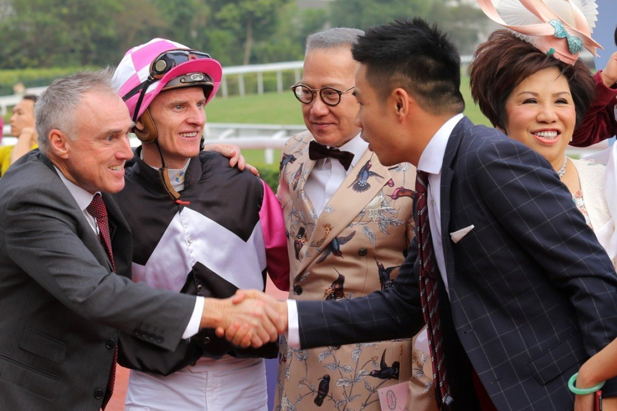 Paul O'Sullivan and Zac Purton celebrate Win Beauty Win's victory with connections. Photos: Kenneth Chan