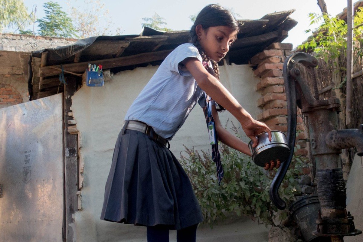 Arti, six, gets ready for school. Her mother, Babita Kumari Yadav, of Potohr village, was married as a young teen and received no education. She hopes that Arti will not marry until after she has finished her studies. Pictures: Abby Seiff