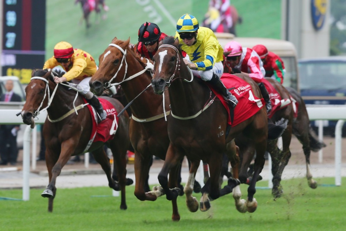 Tommy Berry pushes out Werther to collect the Group Two Jockey Club Cup at Sha Tin on Sunday. Photos: Kenneth Chan