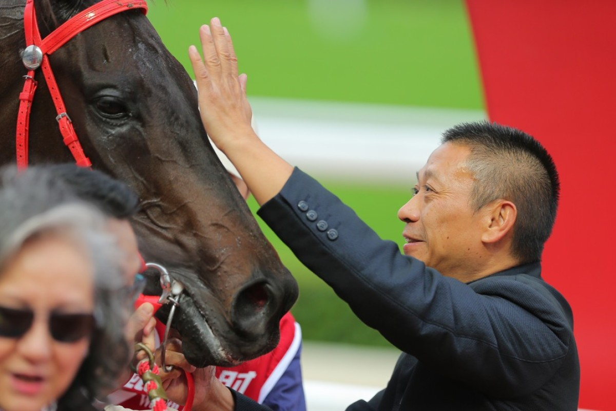 Trainer Danny Shum gives Seasons Bloom a pat after winning the Group Two Jockey Club Mile. Photos: Kenneth Chan
