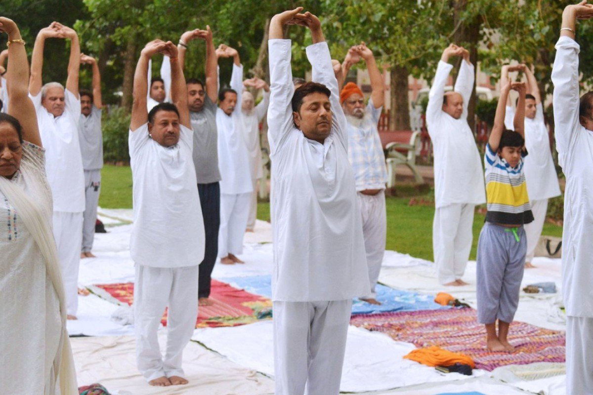 The yoga pose surya namaskar, meaning sun salutation, is among Indian English additions to the Oxford English Dictionary. Picture: AFP