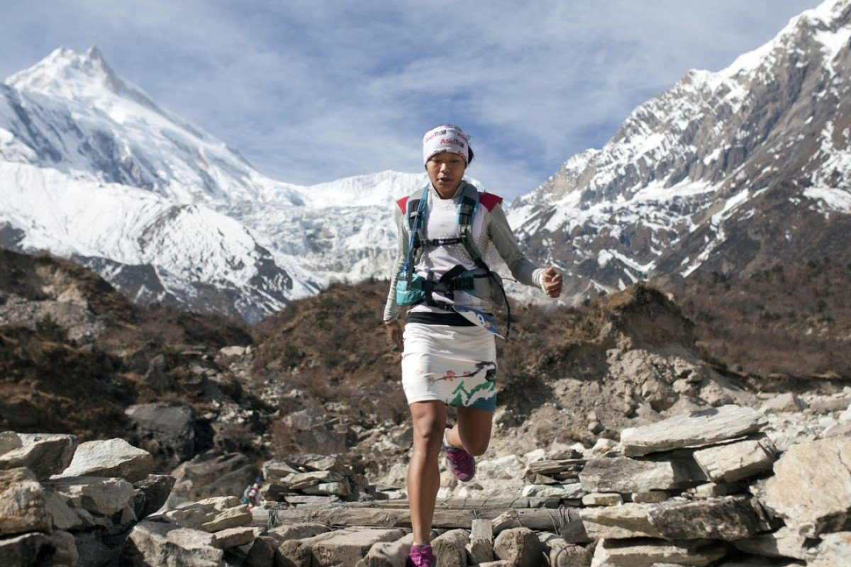 Nepalese runner Mira Rai runs in the mountains in Nepal.