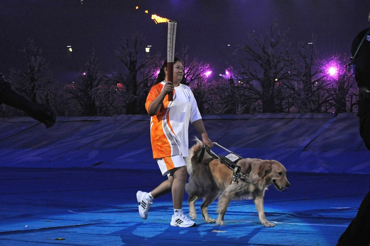 Ping Yali with her guide dog Lucky at the Beijing Olympics. Photo: AFP