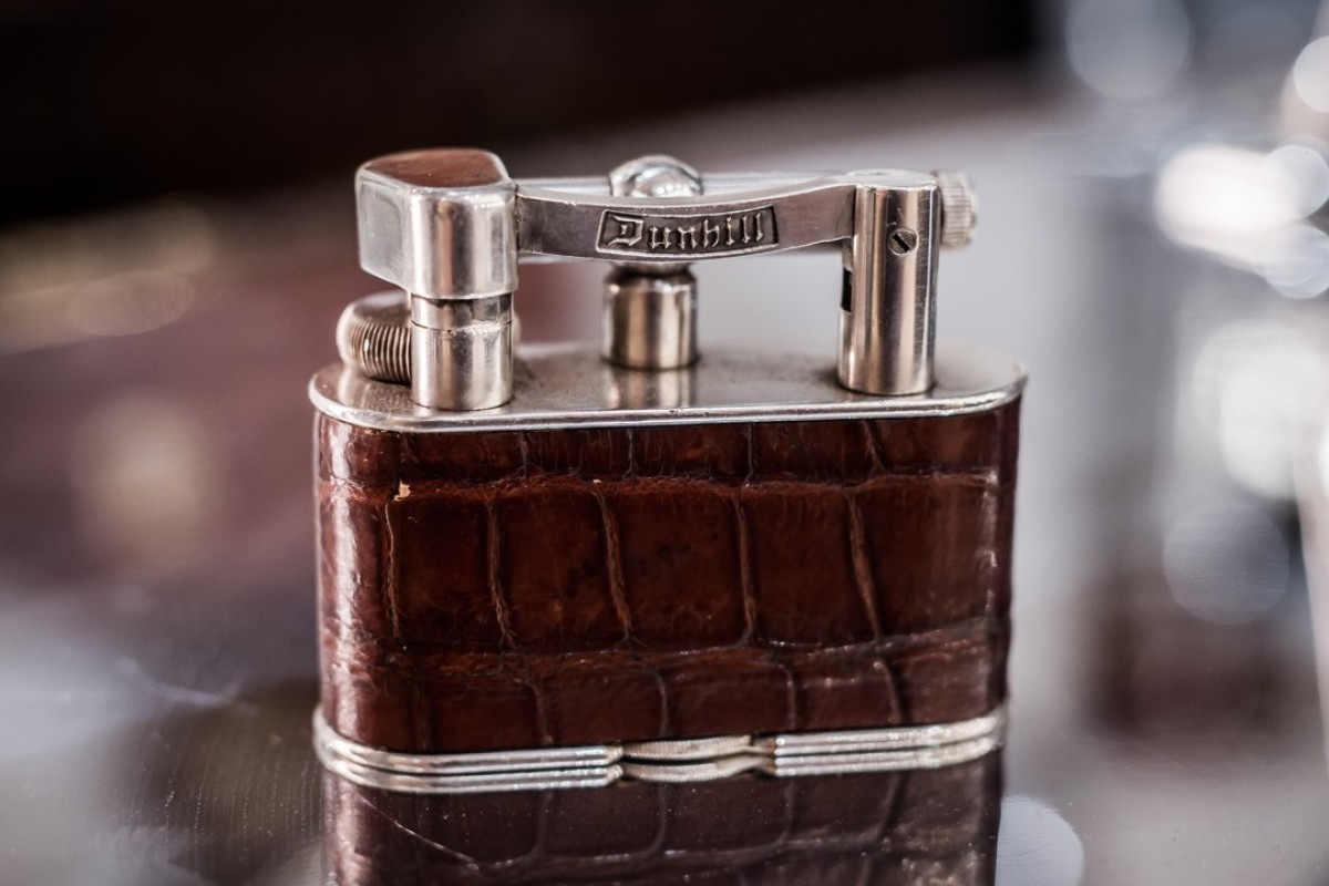 A 1930s Mini Dunhill alligator leather lighter. Photo: Timothy Oulton